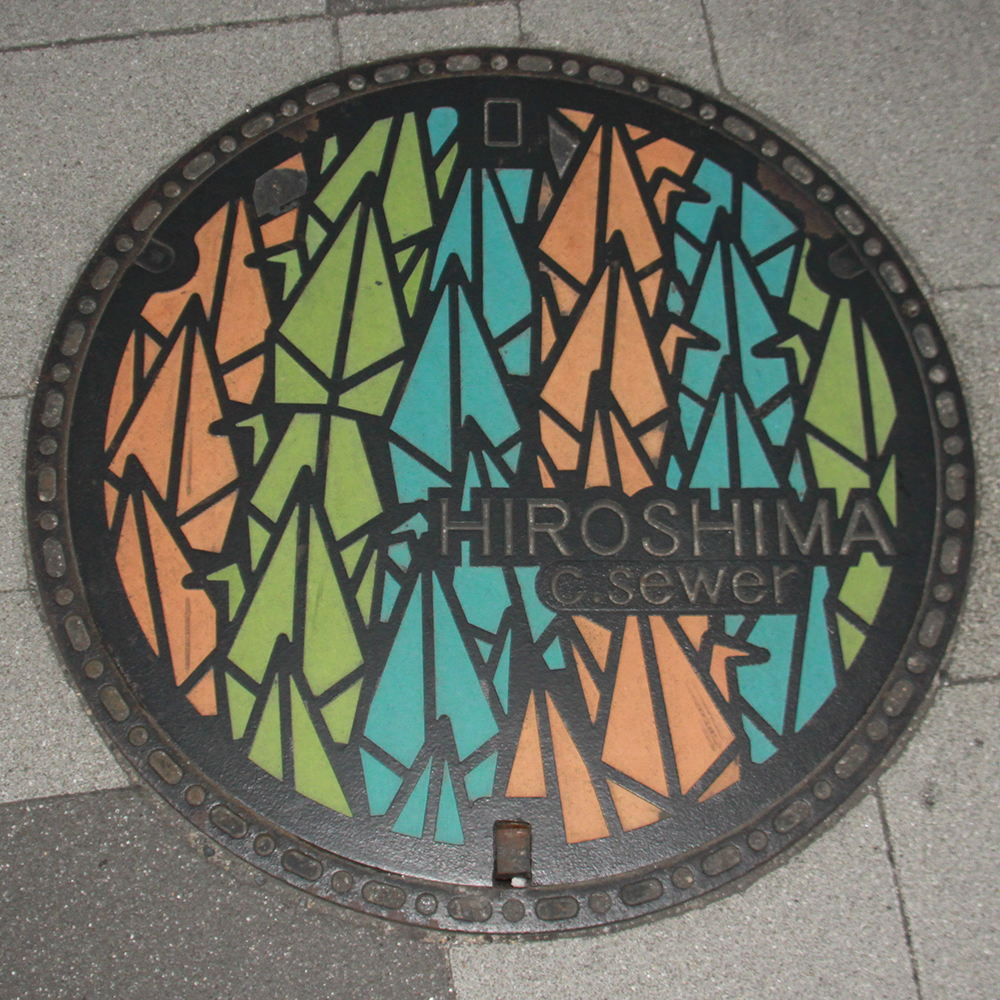Hiroshima Manhole Cover - Photo by PINEAPPLE Studio