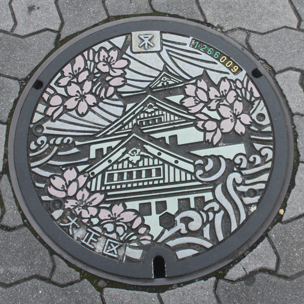 Osaka Manhole Cover - Photo by PINEAPPLE Studio