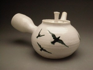 ceramic tea pot with painting of birds flock