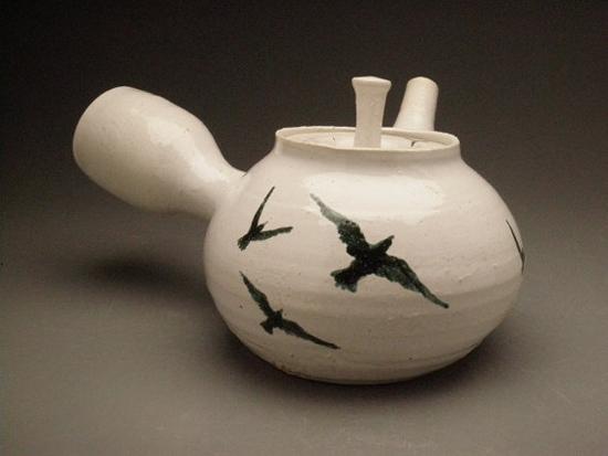 ceramic tea pot with painting of birds flock